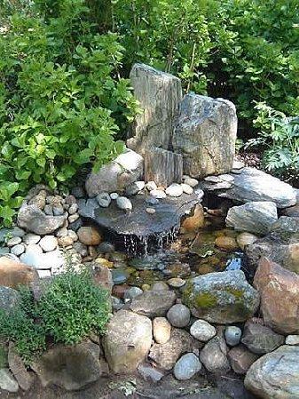 Jardines con piedras 45 fotos y sugerencias para su dise o - Fuentes de jardin de pared ...
