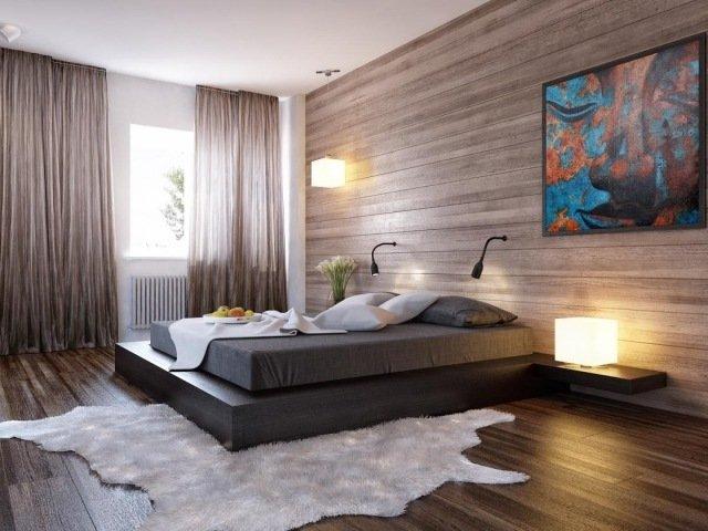pared de madera con cuadro azul, cama marrón, cortinas marrones