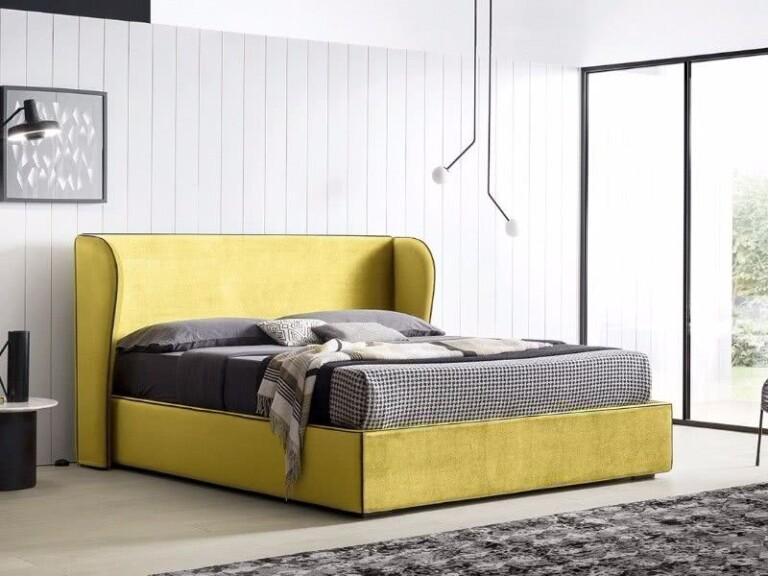 cama amarilla, dormitorio gris