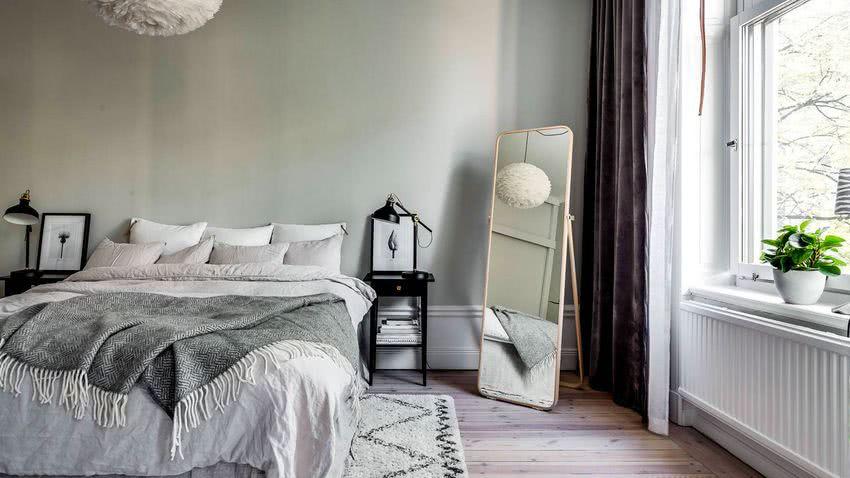 paredes en verde menta cama en blanco y gris